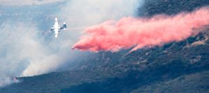 Firefighting plane drops retardant.